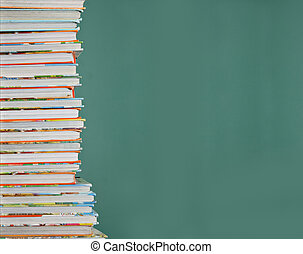 Tall stack of childrens school books.