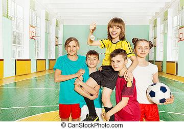 Children's soccer team celebrating victory