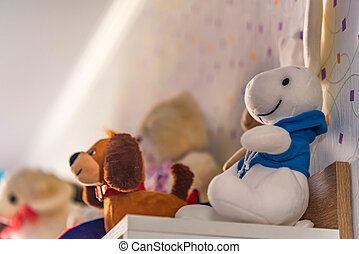 Children's soft toys on shelf - Close up teddy rabbit and ...