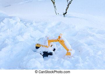 Children's toy forgotten in the snow