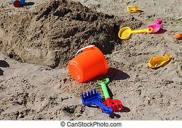 Children's toys on the beach sand