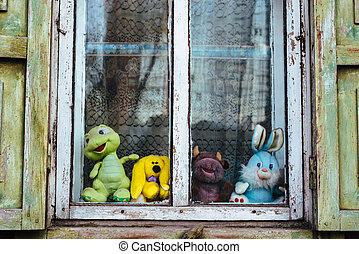 children's toys on the old village window