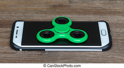 Childrens toys; Smartphone with a spinner on top
