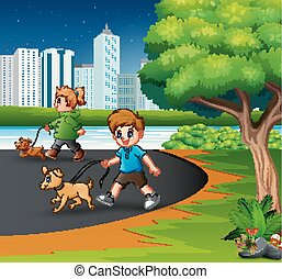 Childrens walking with their pets at the city park