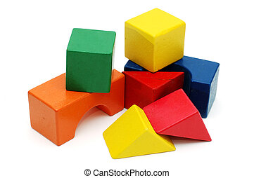 Children's wooden blocks photographed over white background