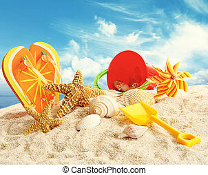 Child's beach toys in the sand