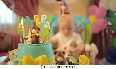 Child's Birthday Party - Little boy and cake on birthday