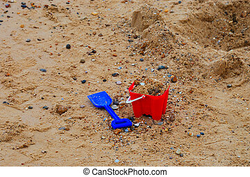 childs bucket and spade by sea