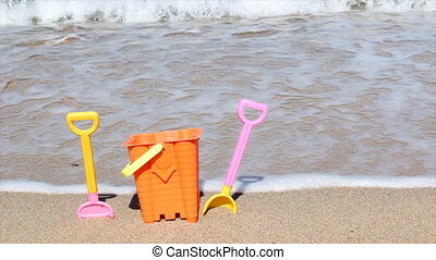 child's bucket and spade on beach