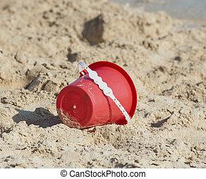 Childs bucket on a tropical beach