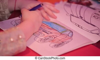 child's drawing with crayons on white paper