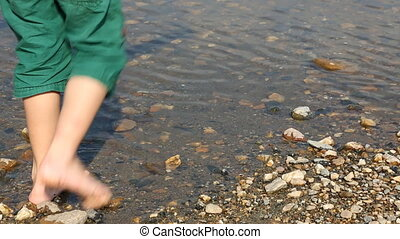Child's feet in water
