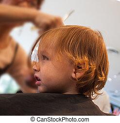 child's first hair cut at salon