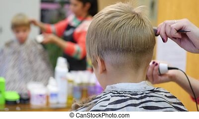 Childs haircut at the barber shoplooking at yourself in the mirror childs haircut at the barber shoplooking at yourself in the mirror solutioingenieria Images
