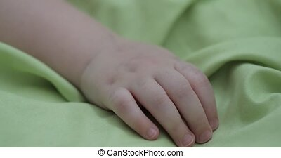 child's hand on a blanket close-up.