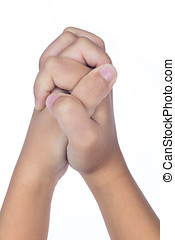 Child's hands folded together in prayer in isolated white...