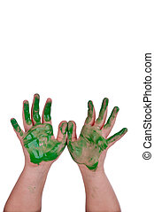 child's hands in green paint