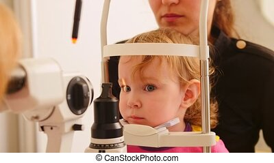 Child's healthcare - ophthalmology - doctor checks eyesight...