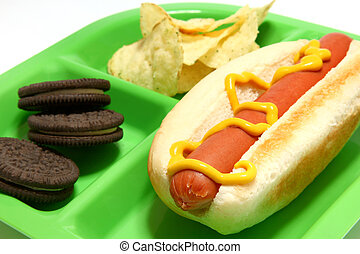 Child\\\'s Lunch - Hotdog, chips, cookies on childs tray.