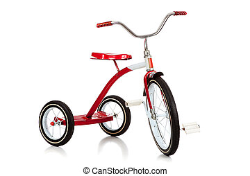 Child's red tricycle on white