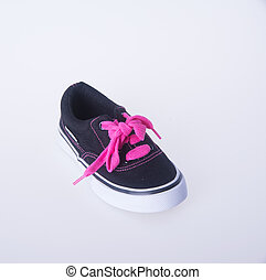 child's shoes on background