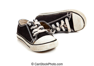 Childs tennis shoes on White