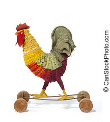 Colorful vintage childs toy rooster on wheels to pull along rare and unusual isloated on white