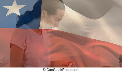 Animation of Chilean flag waving over a sick Caucasian woman sitting at home coughing taking temperature. Global coronavirus pandemic concept digitally generated image.