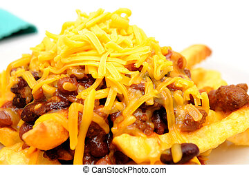 Chili Cheese Fries - Melting cheddar cheese over the top of...