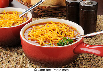 Chili con carne topped with cheese - A crock of chili con ...
