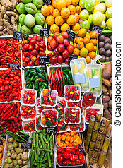 chili pepper and other vegetables on spanish market