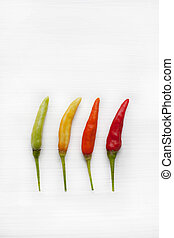 Chili peppers on white.