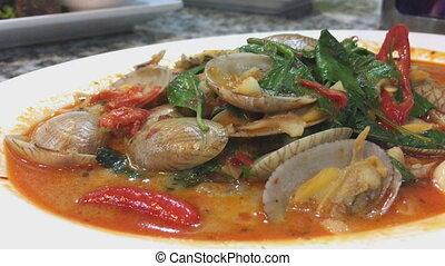 Chili sauce sambal clam Singaporean Malaysian seafood dish...