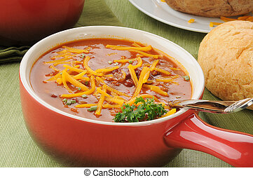 Chili with cheese in a serving crock