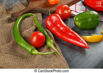 Chilies on a piece of burlap. Top view.