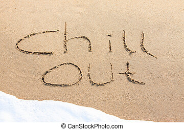 Chill out - written in the sand with a foamy wave underneath