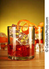 Chilled Alcohol Drink with Ice Cube and Orange Peel