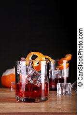Chilled Alcohol Whisky / Rum Drink with Ice Cube and Orange Peel