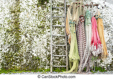 Chilled fishing nets hung on the wall with ladder