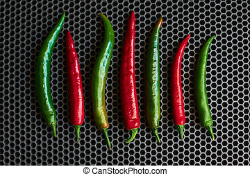 chilli hot red and green close-up on a dark background from above