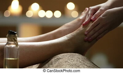 Chilling - Side view of ankles and soles given massage and...