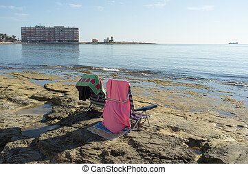 Sunny chillout scene, chairs on a sunny Mediterranean beach