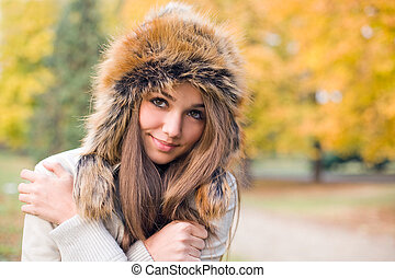 Portrait of gorgeous young model dressed up for chilly weather.
