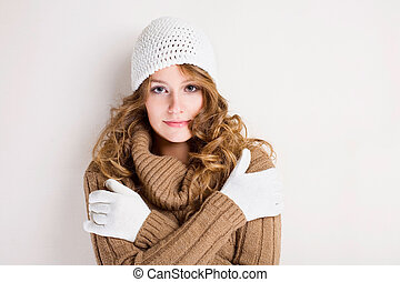 Portrait of a beautiful chilly winter fashion girl in turtleneck sweater.