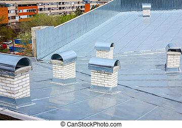 Chimney made of white bricks, roof ventilation system