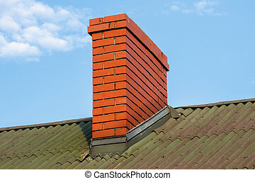 Chimney on roof of house on sunny day