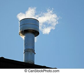 chimney on the roof with smoke