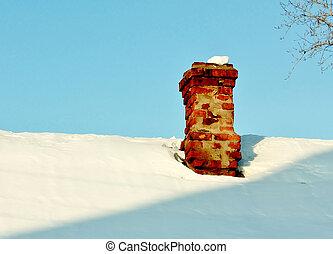 chimney - red brick chimney of farmhouse in winter