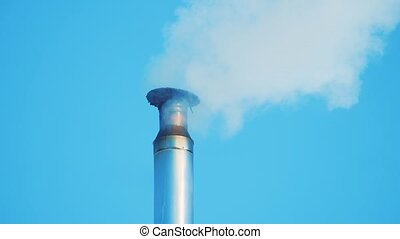 chimney roof pipe winter snow. chimney chemical factory....