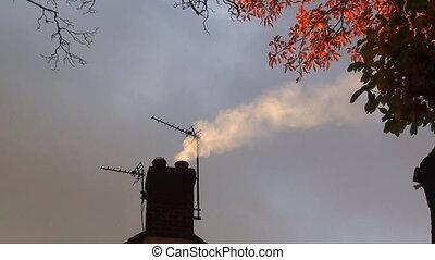 chimney smoke on house